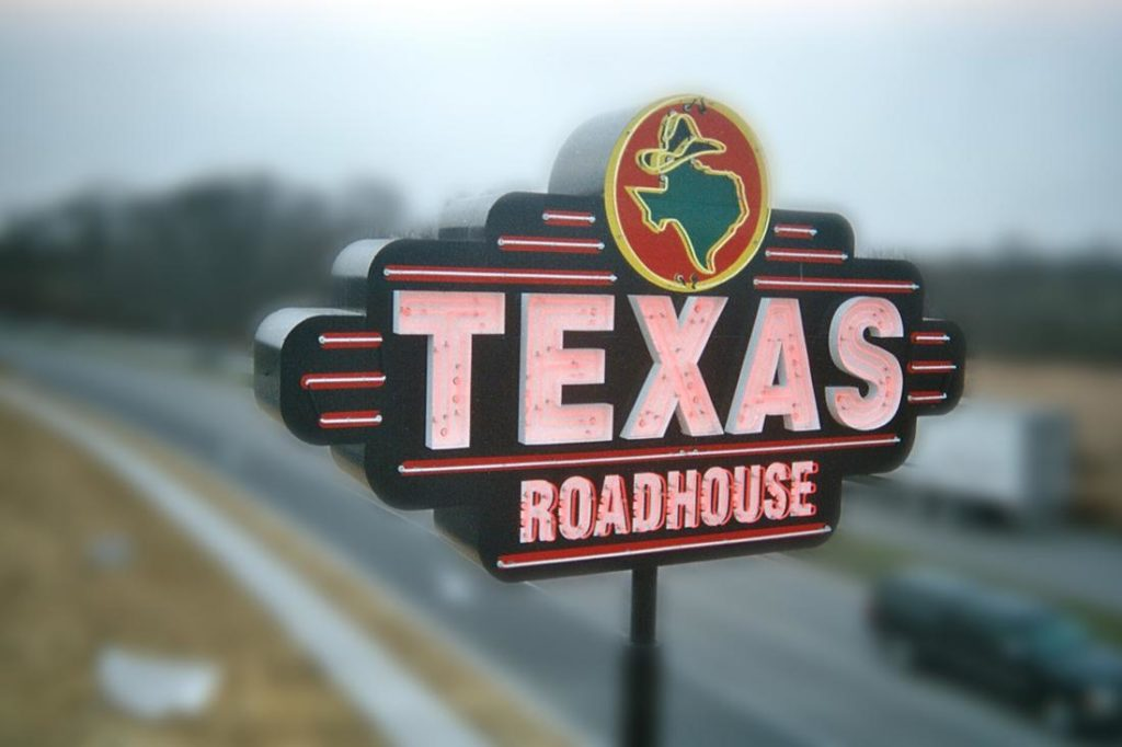 texas roadhouse neon open face pylon sign