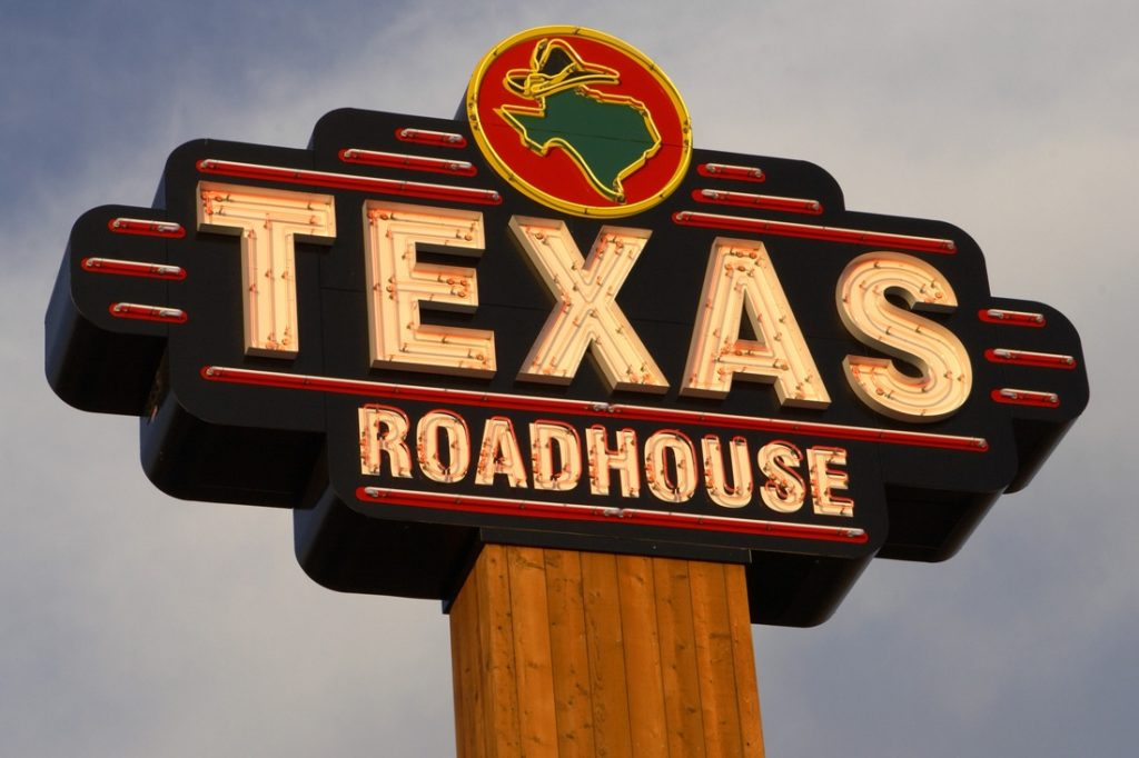 texas roadhouse neon open face channel letters on pylon sign