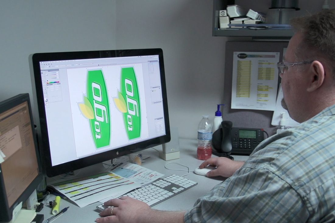 man working on artwork at computer