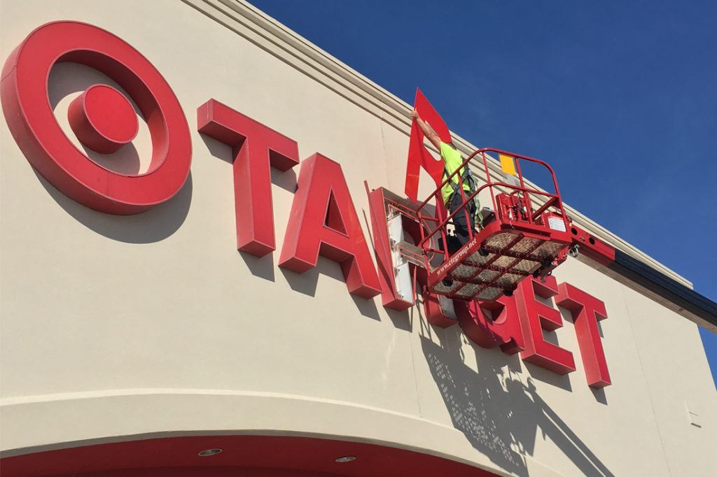 man doing retrofit maintenance on target channel letters