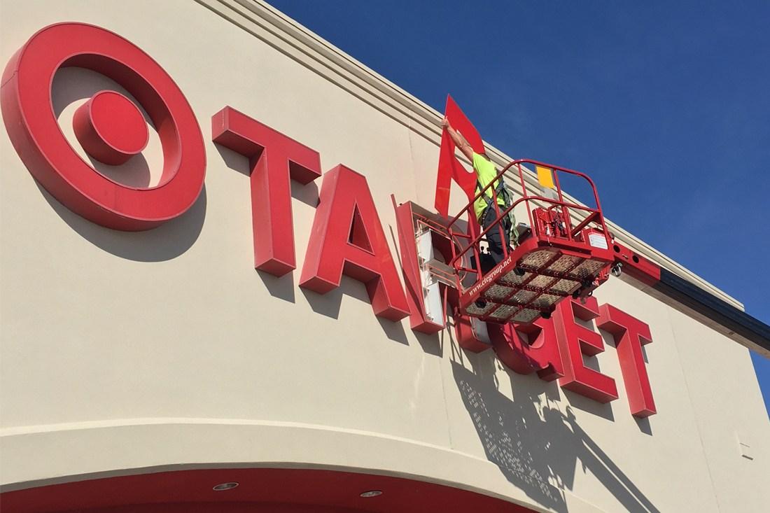 man doing retrofit maintenance on target channel letters