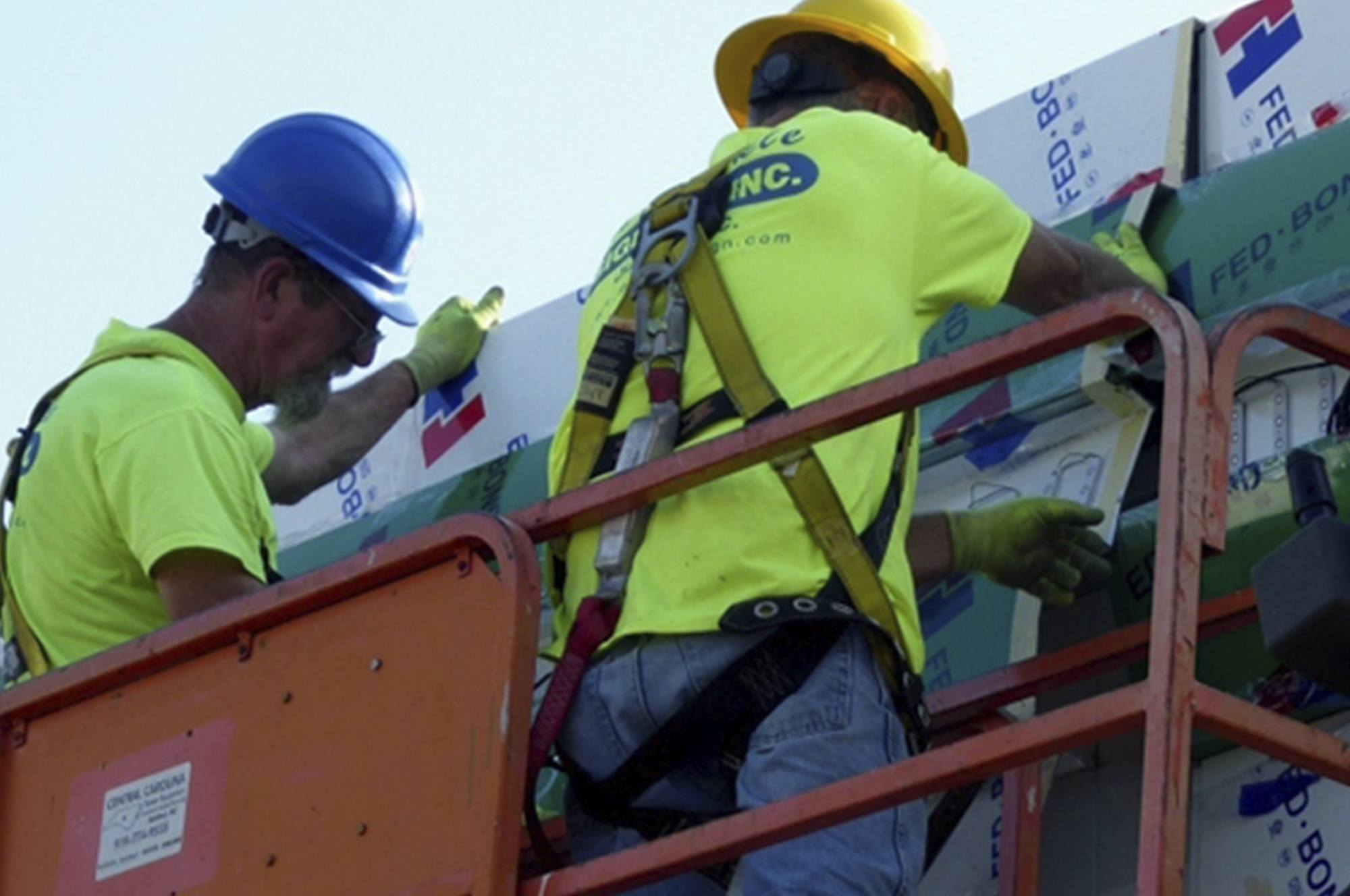 men working on canopy specialty contracting