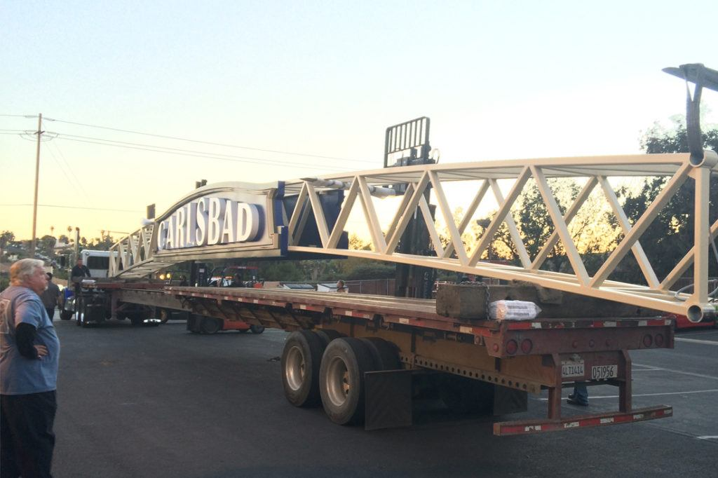 Carlsbad archway sign on flatbed truck