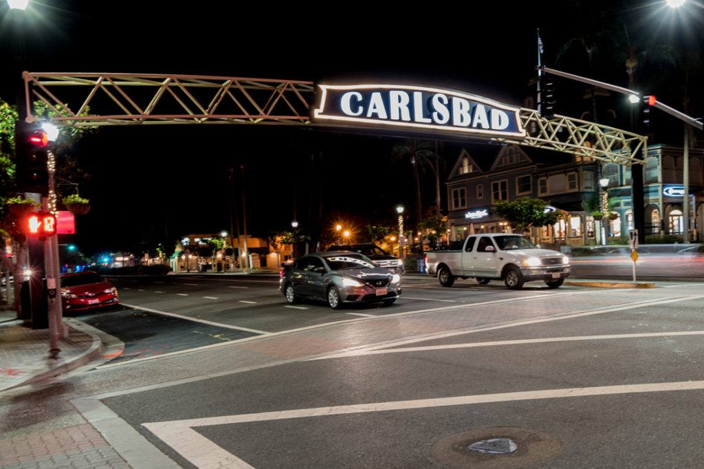 Carlsbad archway sign at night