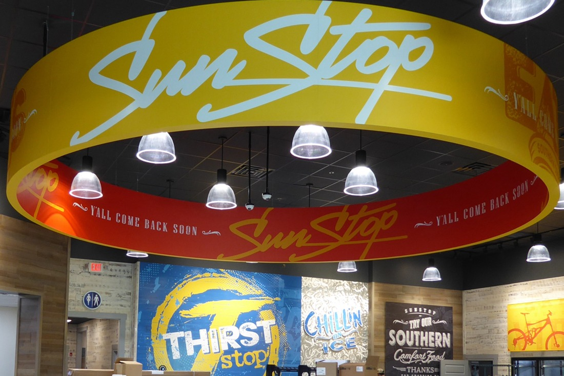 Inland sun stop circular hanging sign