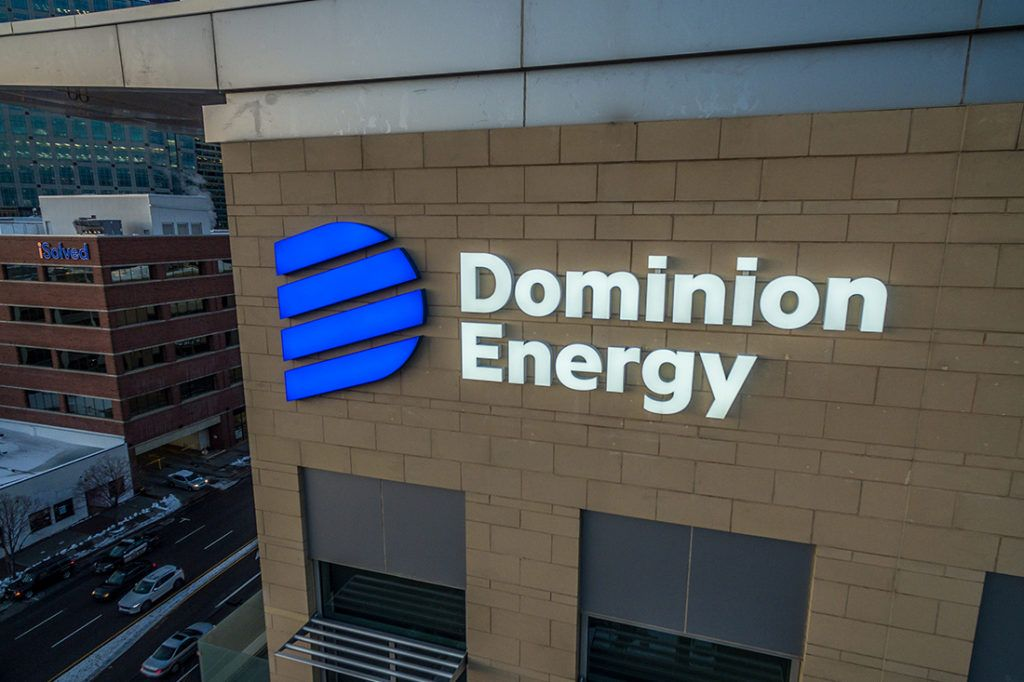 dominion corporate high rise signage at night