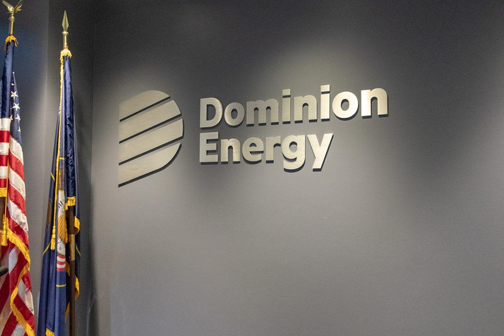 dominion energy interior channel letters next to two flags
