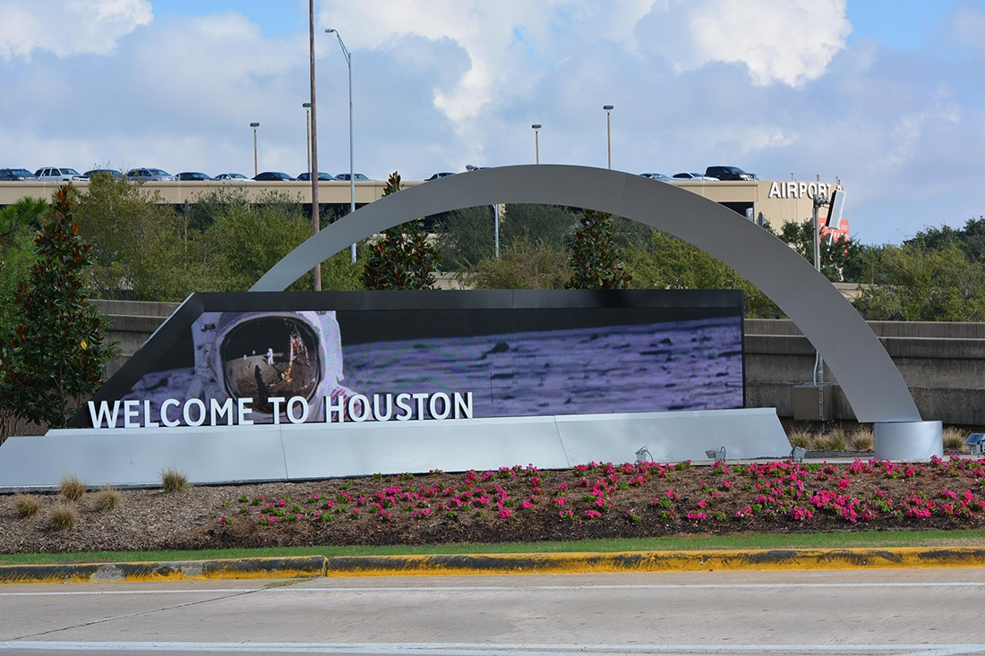 custom sign for houston airport system showing astronaut on screen