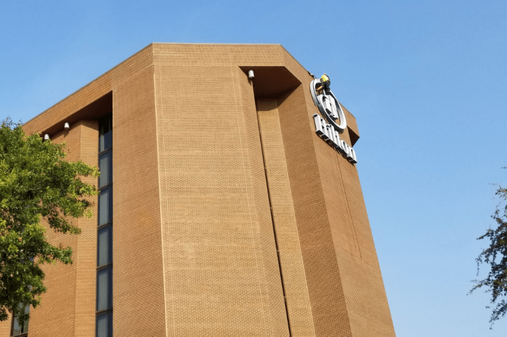 High Rise Sign Rappelling Service